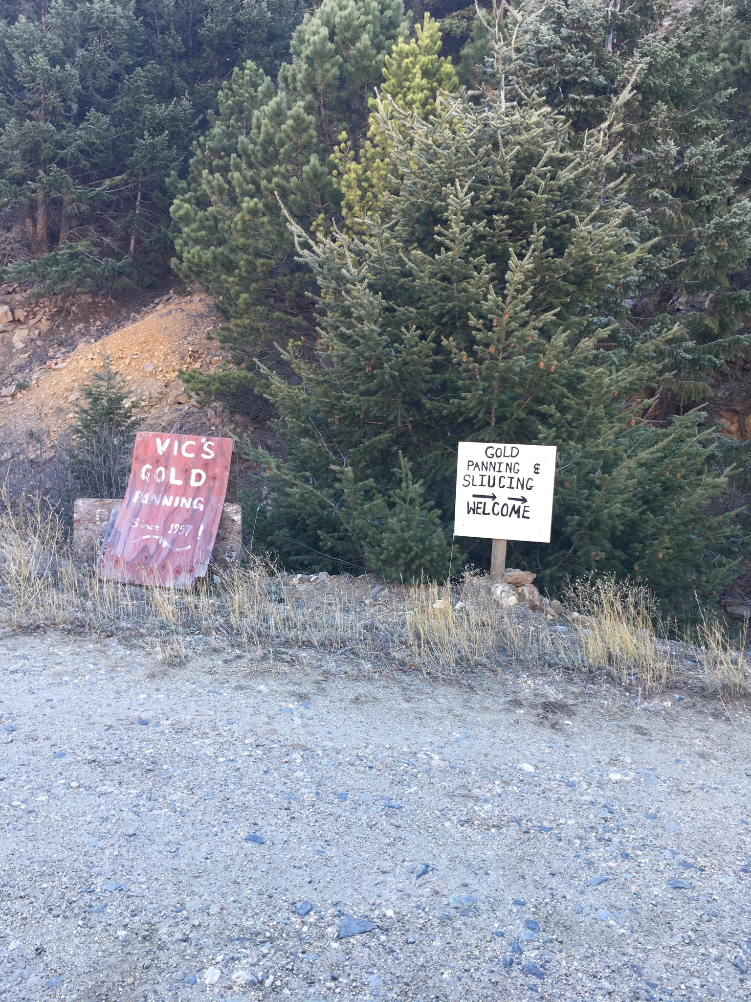Signs at gold panning site